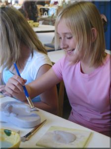 Teen Girl Painting Pottery