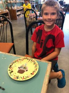 Boy Finished Painting a Cupcake Plate